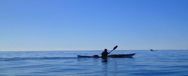 glassy paddle across Sandy Strait